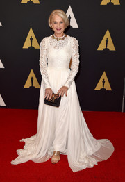Helen Mirren polished off her ensemble with an embellished black clutch.