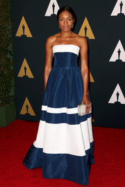 Naomie Harris paired her lovely dress with a frosted box clutch by Rauwolf.