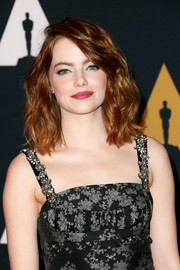 Emma Stone looked stylish with her high-volume waves at the Governors Awards.