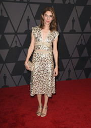 Sofia Coppola kept the shimmer going with a pair of embellished gold sandals.