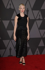 Michelle Williams was equal parts edgy and glam in this mixed-material LBD by Louis Vuitton at the Governors Awards.