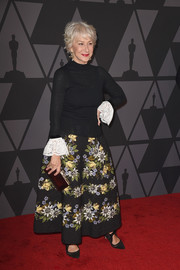 Helen Mirren dressed up her casual top with a floral circle skirt.