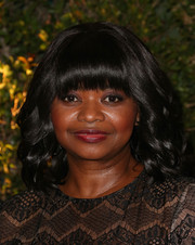 Octavia Spencer topped off her look with a girly shoulder-length curly 'do and blunt bangs when she attended the Governors Awards.