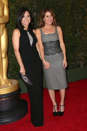 Nicole Holofcener attended the Governors Awards looking sylish in a gray cocktail dress with lace detailing.