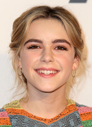 Kiernan Shipka topped off her look with simple yet elegant diamond hoops.