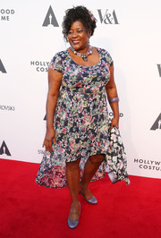 Loretta Devine went for a flirty look in a floral fishtail dress during the Hollywood Costume Opening Party.