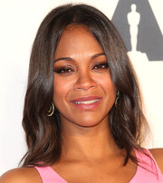 Zoe Saldana opted for a simple face-framing 'do with gentle waves down the ends when she attended the Hollywood Costume Opening Party.