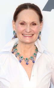 Beth Grant attended the Hollywood Costume Opening Party wearing a stunning gemstone statement necklace and matching earrings.