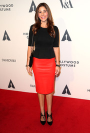 For a bright pop of color, Sheila Vand styled her top with a red pencil skirt.