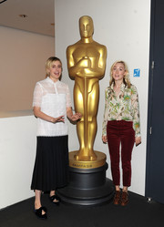 Bow-adorned pointy flats finished off Greta Gerwig's attire.