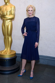 Nicole Kidman complemented her dress with a pair of blue suede pumps by Jimmy Choo.
