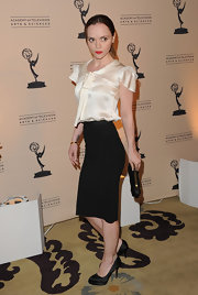 Christina Ricci got a boost from elegant black satin platform pumps.