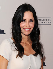 Courtney Cox styled her raven locks in center part curls at the 'Cougar Town' event party.