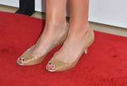 Mary Steenburgen added some spice to her white cocktail dress with these shimmery gold kitten heels with peep toes.