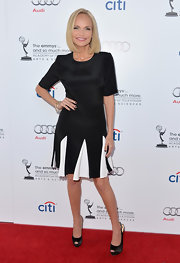 Kristin nailed the black-and-white look when she donned this black satin dress with fun white godets on the skirt.