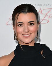 Cote de Pablo wore triple-drop dangle earrings on the red carpet for the Academy of Television Arts & Sciences Hall of Fame Induction Gala.