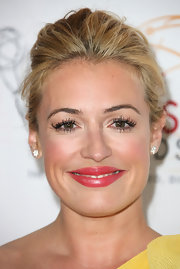 Cat Deeley wore a pearlescent muted raspberry-colored lipstick at the College Television Awards.