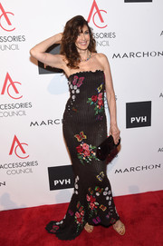 Carol Alt finished off her look with a black patent clutch by Louis Vuitton.