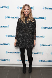 Annie Murphy contrasted her delicate frock with chunky black lace-up boots.