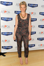 Amy Smart went matchy-matchy at her PetArmor Protection Promise launch in these print pants and matching blouse.