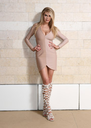 Charlotte McKinney wrapped up her curves in a two-tone mini dress by House of CB for the grand opening of NightSwim.