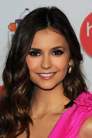 Nina Dobrev added a pair of lashes to complete her shimmery smoky-eyed look.