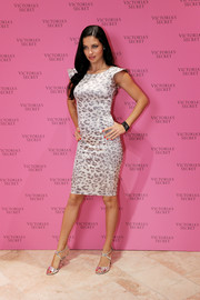 Adriana Lima complemented her dress with silver Jerome C. Rousseau Popp sandals for a bit of shine.
