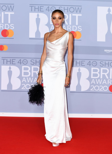 Adwoa Aboah Feathered Clutch [red carpet,dress,carpet,clothing,shoulder,fashion model,gown,flooring,premiere,fashion,red carpet arrivals,adwoa aboah,brit awards,england,london,the o2 arena,the brit awards 2020,adwoa aboah,2020 brit awards,red carpet,model,fashion,elle,vogue,stormzy,justin bieber,harry styles]
