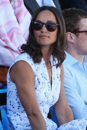 Pippa Middleton left her shoulder-length hair in loose curls at the Aegon Championships in London.