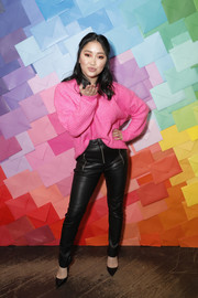 Lana Condor stayed cozy in a pink crewneck sweater at the Evening of Change event.