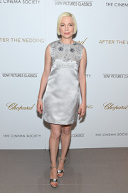 Michelle Williams was '60s-glam in a silver Louis Vuitton shift dress with a beaded bodice at the New York screening of 'After the Wedding.'