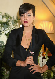 Lily Allen paired her black blazer with a flamingo pendant.
