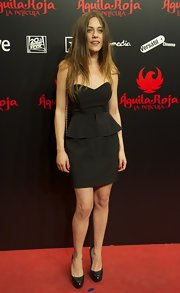Spanish Actress Maria Leon attended a film premiere in Madrid looking fashionable in this strapless black peplum dress.