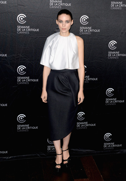 Rooney rocked a totally structured look with this pale gray silk cape.