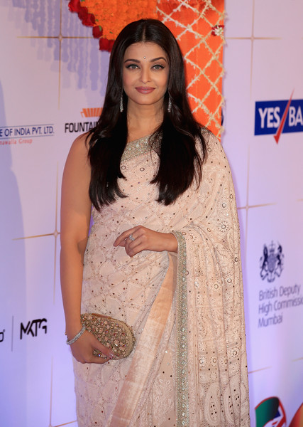 Aishwarya Rai Diamond Bracelet [clothing,fashion design,fashion,long hair,red carpet,peach,carpet,premiere,formal wear,dress,aishwarya rai bachchan,india,bhutan,the duke duchess of cambridge,taj mahal palace hotel,mumbai,visit,bollywood inspired charity gala,visit]