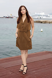 Aishwarya Rai looked stylish in a silk olive wrap dress and black heels at Cannes.