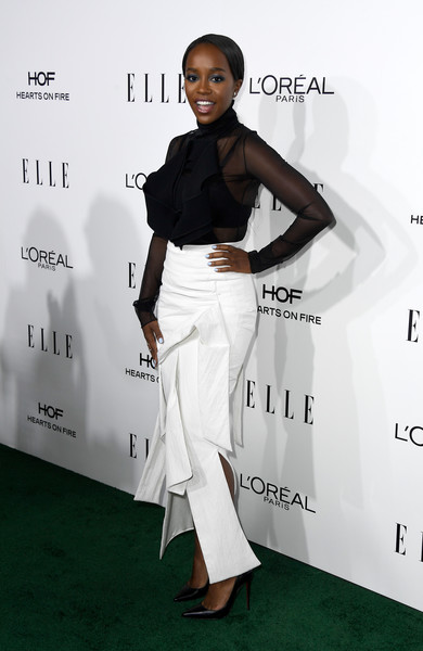 Aja Naomi King Sheer Top [white,fashion model,flooring,formal wear,shoulder,fashion,catwalk,outerwear,carpet,suit,honoree aja naomi king,arrivals,los angeles,four seasons hotel,california,beverly hills,elle women in hollywood awards,annual elle women in hollywood awards]