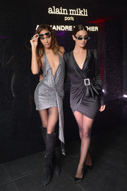 Joan Smalls teamed her dress with black knee-high boots.