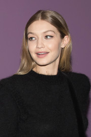 Gigi Hadid sported a hippie hairstyle while waiting backstage at the Alberta Ferretti fashion show.