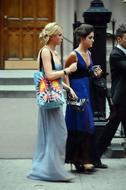 Ireland carried a tie-dye peace tote to transport her things at a wedding.