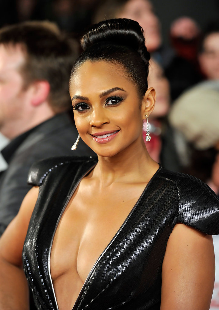 Alesha Dixon's flamboyant top-knot competed for attention with her cleavage during the National Television