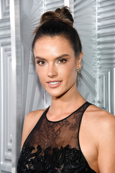 Alessandra Ambrosio Hair Knot [hair,face,hairstyle,eyebrow,beauty,lip,chin,black hair,shoulder,eyelash,24th annual women in hollywood celebration,calvin klein,arrivals,alessandra ambrosio,real is rare,los angeles,four seasons hotel,elle,loreal paris,real is a diamond]
