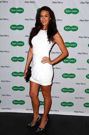 Megan Gale paired classic lace pumps with a sexy little white dress when she attended the Alex Perry eyewear launch.