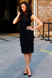 Megan Gale looked downright elegant in a little black dress with bead and lace accents during the Alex Perry fashion show.