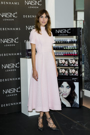 Alexa Chung kept up the demure vibe with a pair of black lace ankle-tie pumps by Bionda Castana.