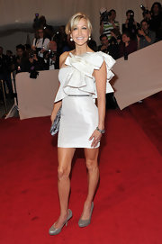 Lara looked perfectly playful at the Met Gala in a one-shoulder white ruffled frock.