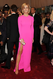 Brooklyn Decker added shine to her neon pink gown with a gold metallic clutch.