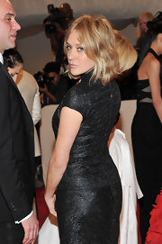 Chloe Sevigny styled her golden locks in a center part straight cut for the 2011 Met Gala.