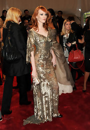 Karen Elson teamed her elegant sequined gown with a white hard case clutch.