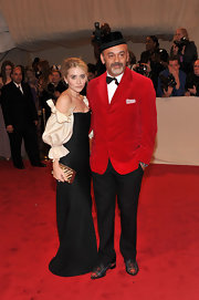 Christian donned a crimson red velvet blazer with plaid shoes for the Costume Met Gala.